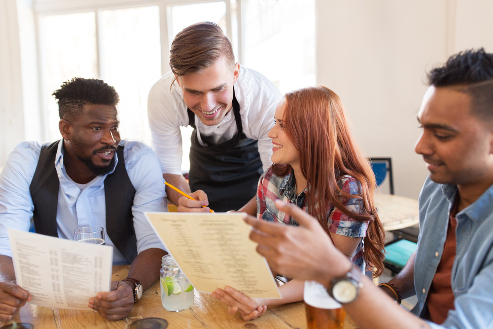 waiter-and-friends-with-menu-a