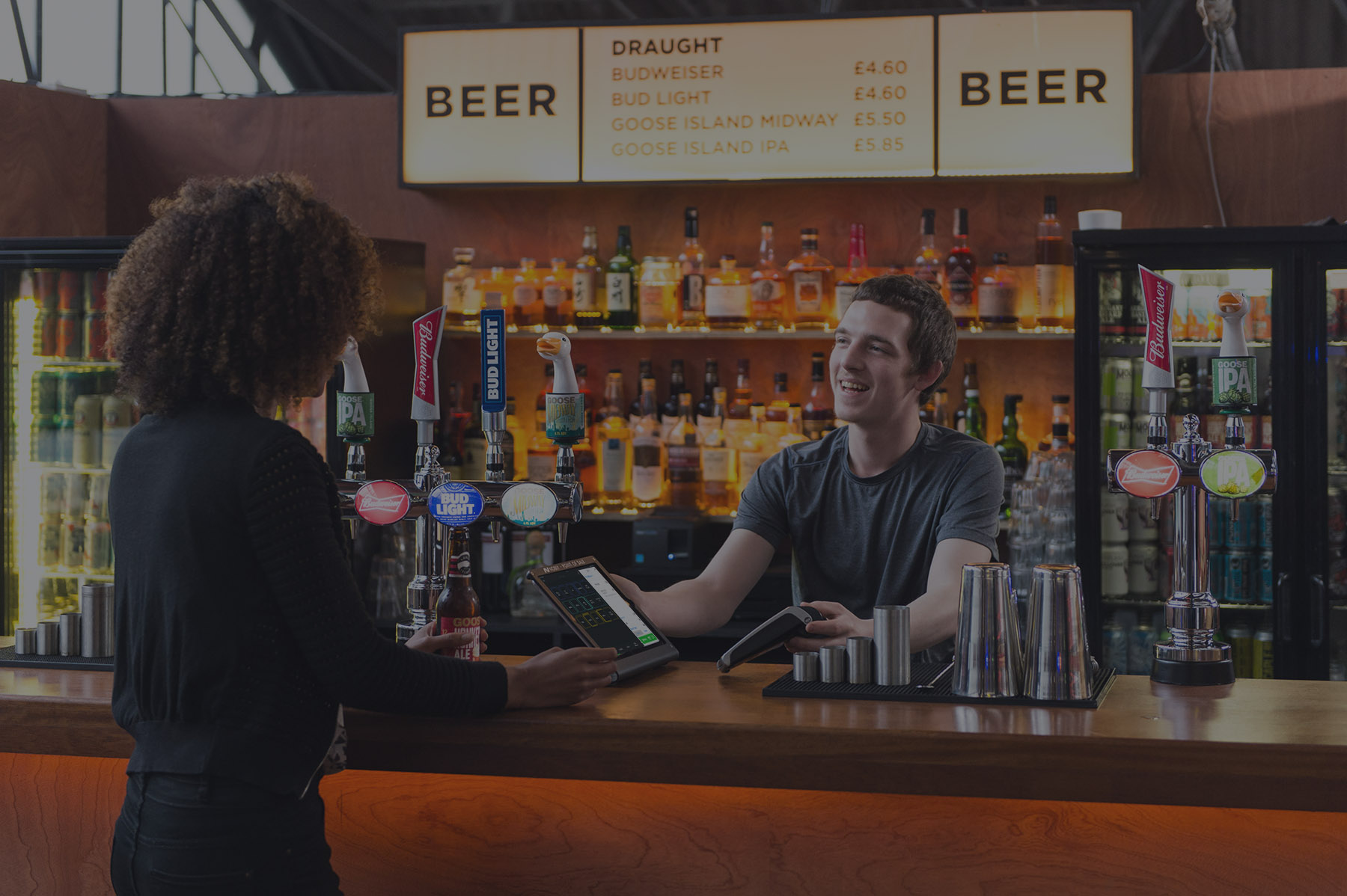 Bar staff taking payment