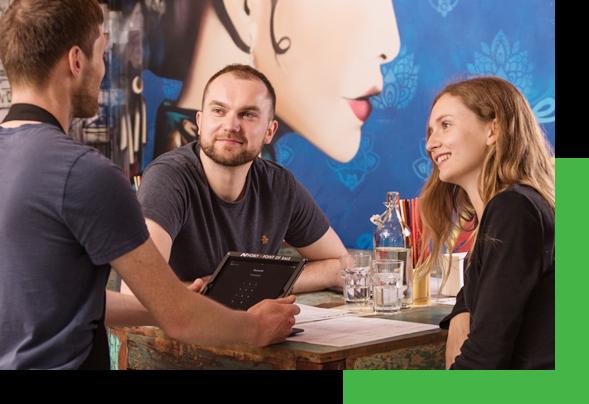 Waiter Using Nobly's Restaurant iPad POS System